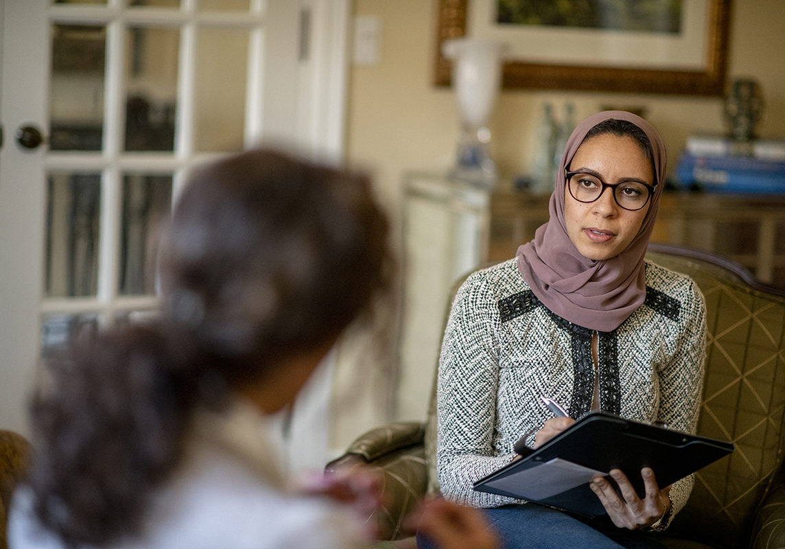Young Muslim woman at a counselling session.